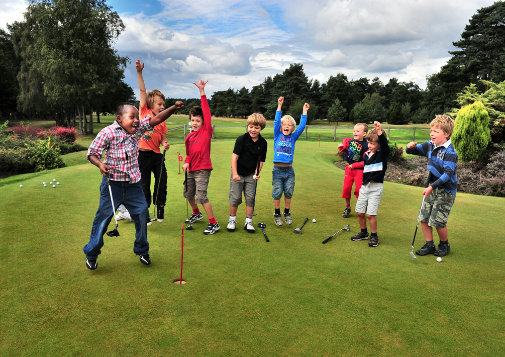 Junior golfers have fun during a clinic at Continental Country Club